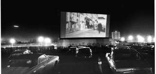 Locals attend a drive-in movie theater on Sunrise