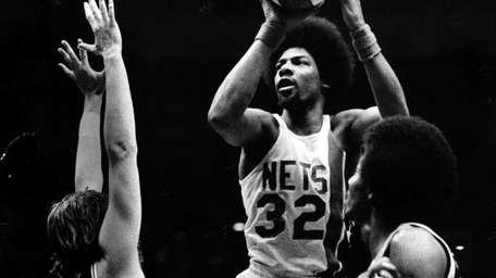 Julius Erving of the New York Nets drives