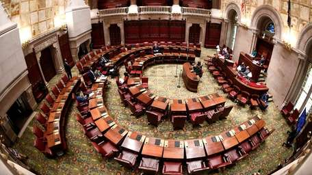 Senators meet in the Capitol in Albany on