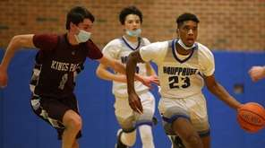 Hauppauge forward Macai John (23) brings the ball