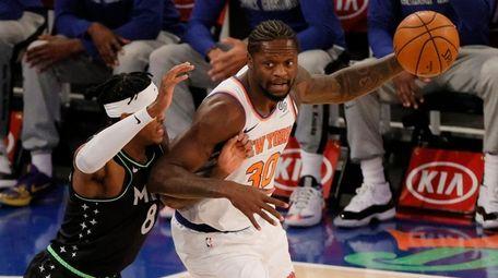 Julius Randle of the New York Knicks dribbles