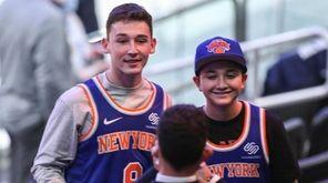 Fans wait for an NBA basketball game between