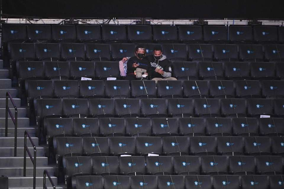 Fans sit in the stands before an NBA