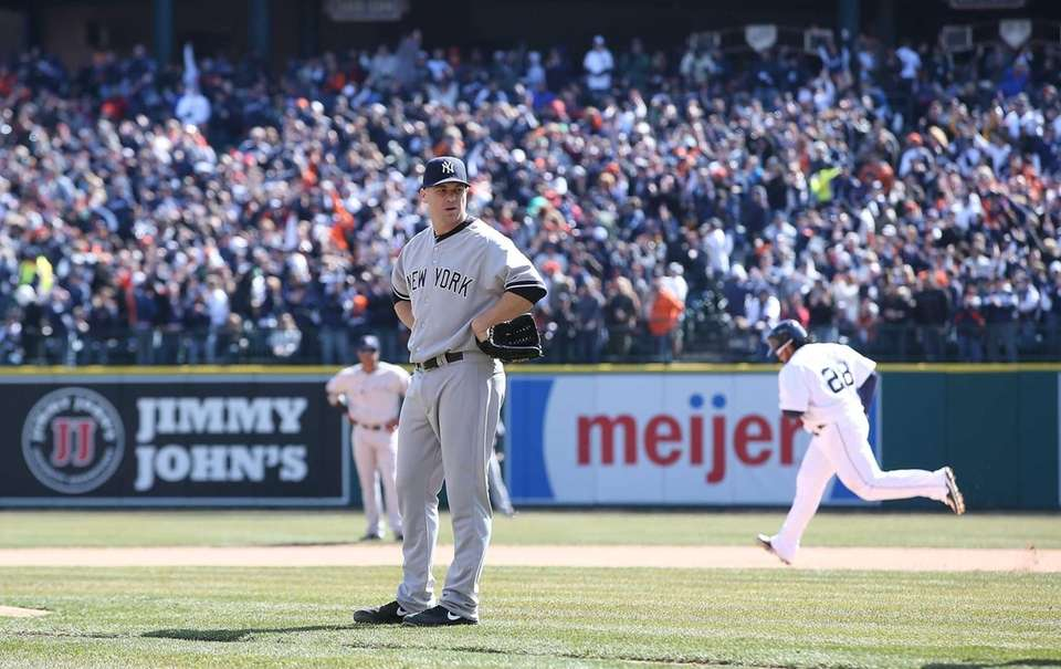 Shawn Kelley of the Yankees reacts after giving