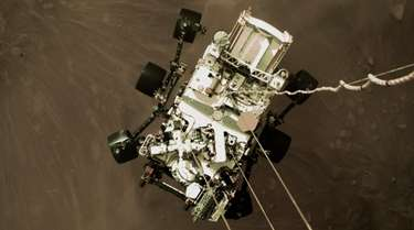 NASA photo shows the Perseverance rover being lowered