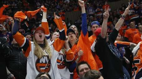 Fans attend the Islanders-Penguins playoff game at Nassau