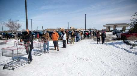 People line up to enter Costco in Pflugerville,