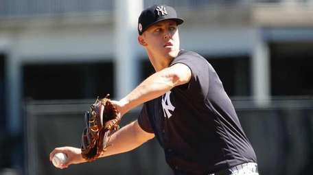 Jameson Taillon of the Yankees throws in a