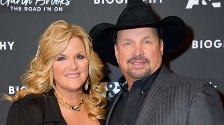 Trisha Yearwood and Garth Brooks attend the