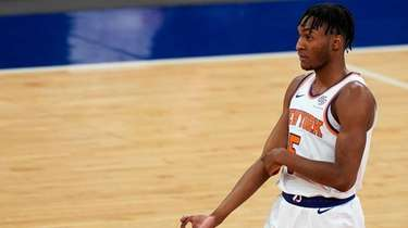 Knicks guard Immanuel Quickley reacts after scoring during