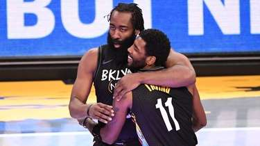 Nets guard James Harden and guard Kyrie Irving