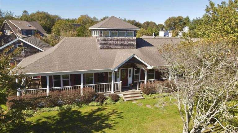This four-bedroom, Nantucket-style ranch, available to rent in Montauk, boasts cathedral ceilings, four gas fireplaces, a chef's kitchen and 3½ bathrooms, three of which are en suite. Credit: Megan Gilman/Laura Altman