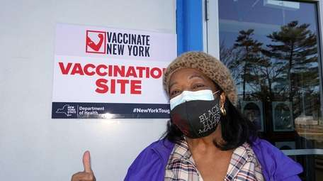 Kathleen King received her COVID-19 vaccine shot at