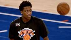 The Knicks' Frank Ntilikina warms up before a