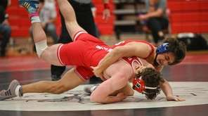 Ion Bobac, of Connetquot, wrestles Rob Dombrowski, of