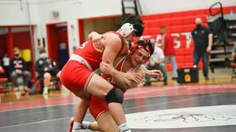 Vincent Catania, of Connetquot, wrestles James Sturek, of