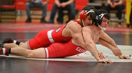 Christian Paredes of Connetquot wrestles against East Islip's