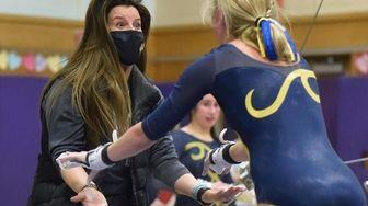 Katie Meehan, Massapequa gymnastics head coach, congratulates Jackie