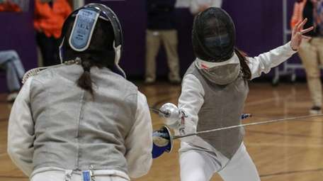 Mandy Li, right, of Great Neck South competes