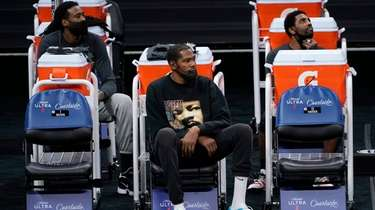 Brooklyn Nets DeAndre Jordan, left, Kevin Durant, center,
