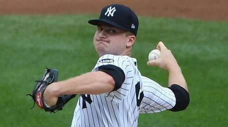 Yankees starting pitcher Clarke Schmidt delivers against the