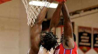 Hills East forward Louis Mathurin(L) gets fouled on