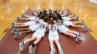 Walt Whitman girls stretch out on the floor