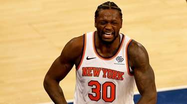 The Knicks' Julius Randle celebrates after drawing a