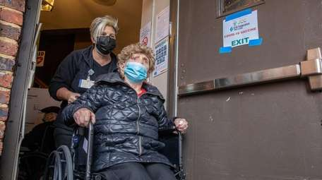 Holocaust survivor Bela Tekiel, 92, is wheeled out