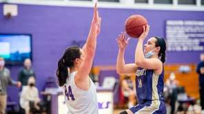 Greenport Adrine Demirciyan (14) against Port Jefferson in