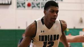 Brentwood forward Isaiah Randolph drives the outside, while