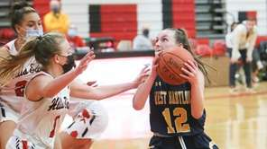 West Babylon's Brianna Winkler (12) drives to the