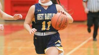 West Babylon's Felicia Barreiros (11) carries the ball