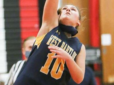 West Babylon's Lacey Downey (10) puts one up