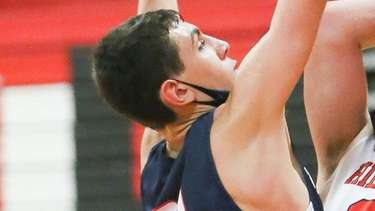Half Hollow Hills East's Adam Kirschenblatt (30) grabs
