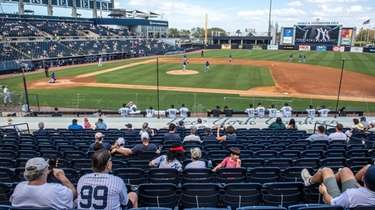 Fans watch a Yankees spring training game at