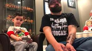 Robert and Gavin Maurus of East Patchogue talk