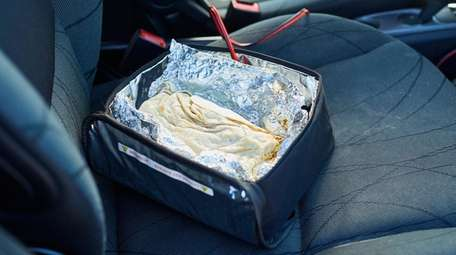 The personal portable oven can reheat food, although