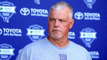 Giants offensive line coach Pat Flaherty speaks to