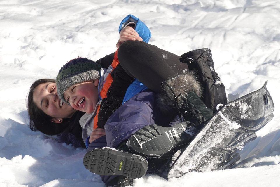 Rhett Williamson, 4, of Manhasset, sleds with his