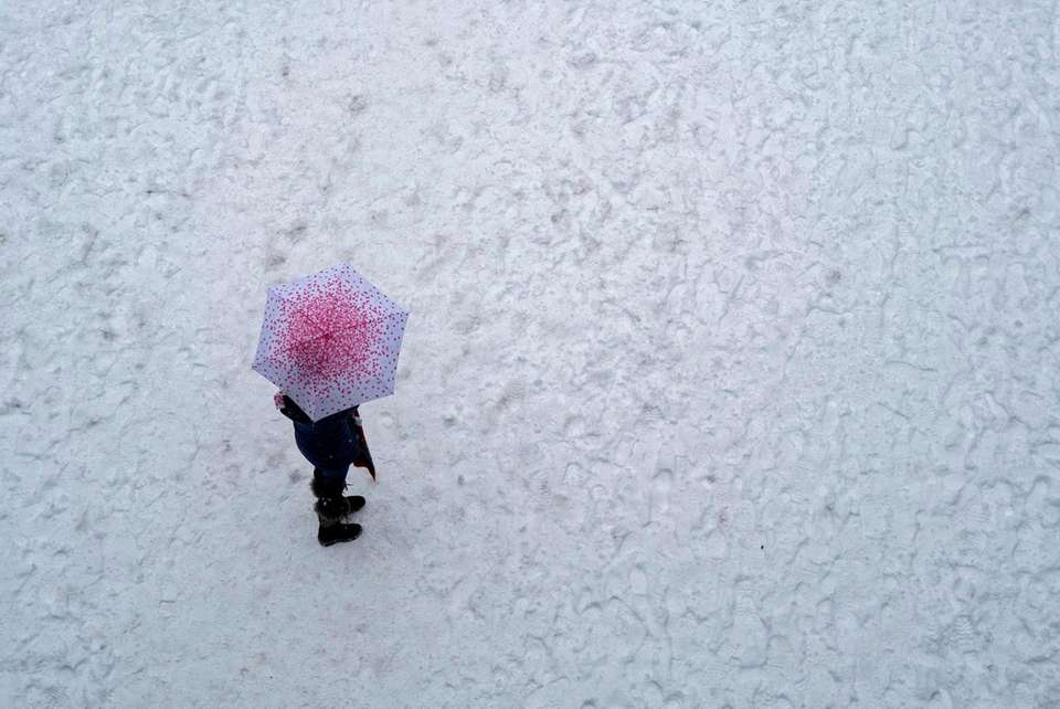 A passerby walks in hundreds of other footprints