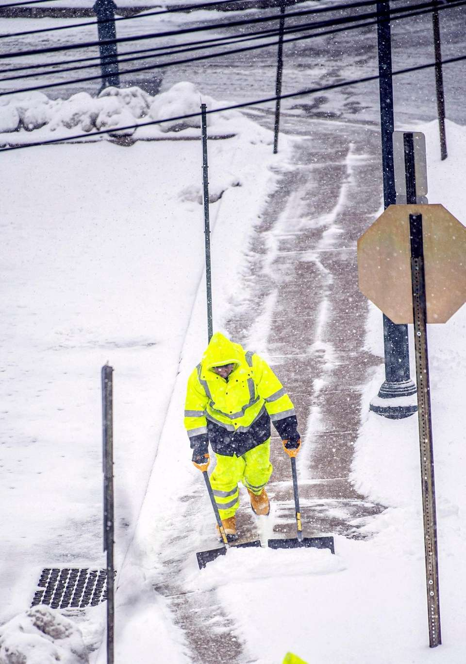 Massapequa Town employees plow the snow of the