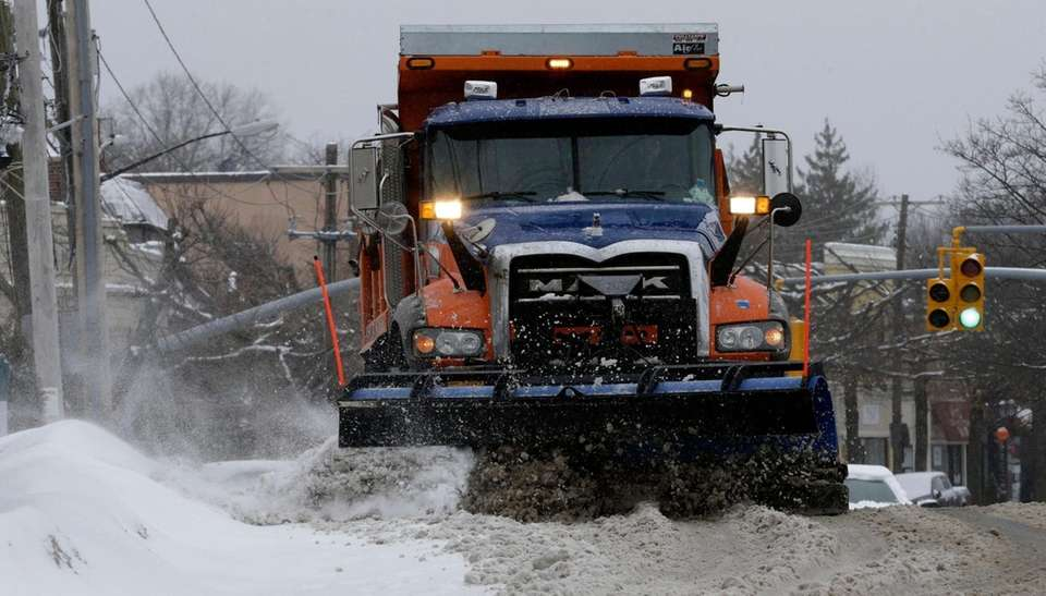 A plow clears Middle Neck Road in Great