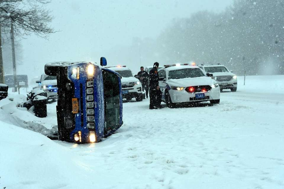 A motorist flipped on its side off the