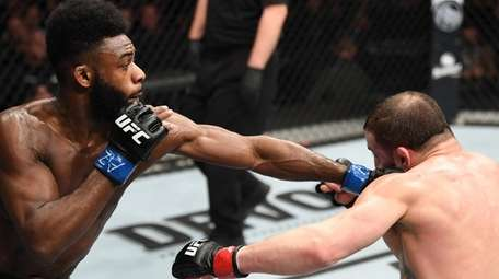 Aljamain Sterling punches Jimmie Rivera in their bantamweight