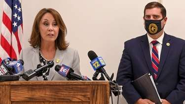 Suffolk County Police Commissioner Geraldine Hart, left, and