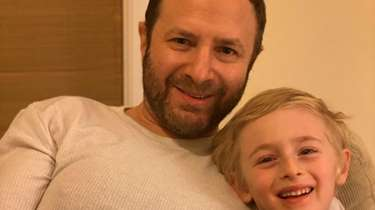 Photo of Josh Wortman, and his son, A.J.,