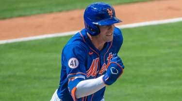 The Mets' Brandon Nimmo runs after hitting a