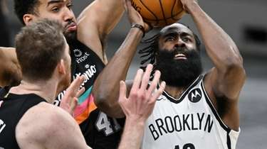 The Nets' James Harden attempts to shoot as