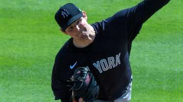 Yankees pitcher Jordan Montgomery throws in the first